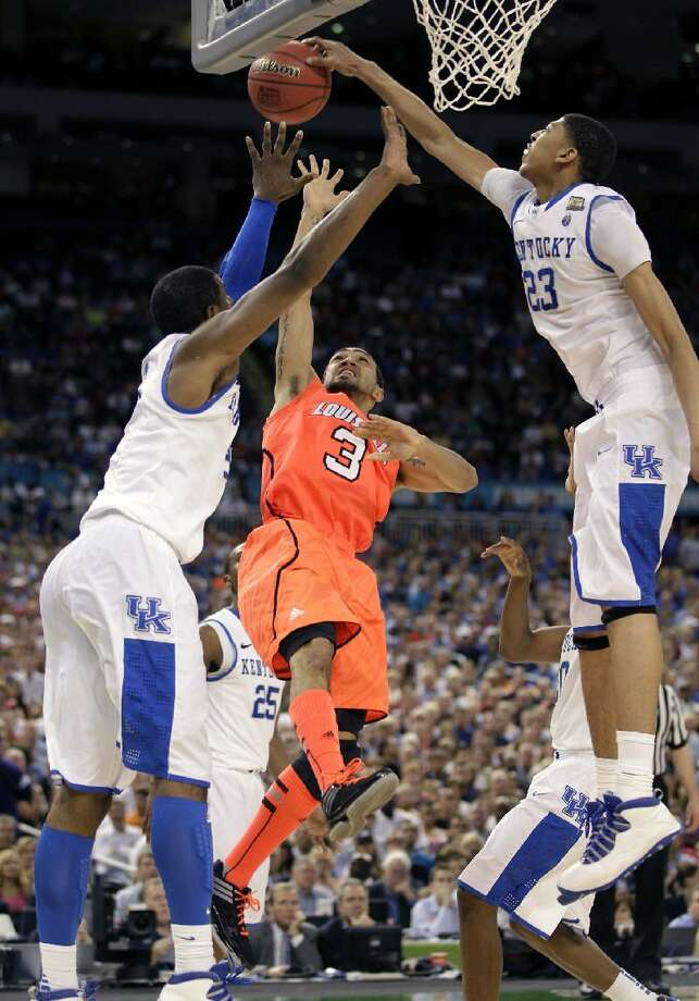 ASSOCIATED PRESS Kentucky forward Anthony Davis (23) blocks a shot by Louisville guard Peyton Siva (3) during the second half of an NCAA Final Four semifinal game Saturday in New Orleans. The Wildcats won 69-61.