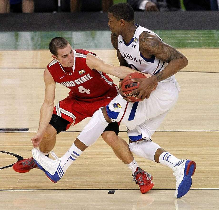 ASSOCIATED PRESS Kansas forward Thomas Robinson drives against Ohio State guard Aaron Craft (4) during the second half of an NCAA Final Four semifinal college game Saturday in New Orleans. The Jayhawks won 64-62.