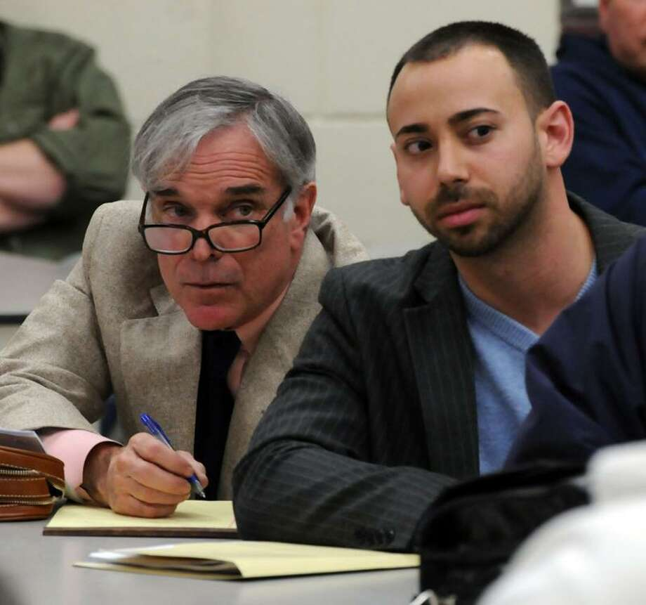 The East Haven Police Commission met to fire Police Chief Leonard Gallo. Gallo's lawyer Jonathan Einhorn, left, and East Haven Town Attorney Joseph Zullo listen to the commission's proceedings. Mara Lavitt/Register