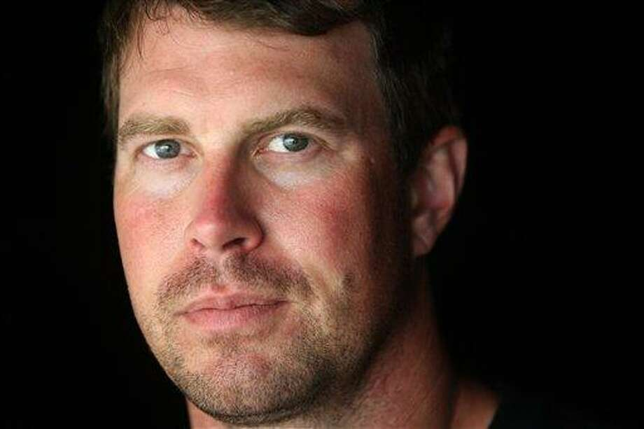 FILE - In this July 27, 2010, file photo, former NFL quarterback Ryan Leaf is shown in Holter Lake, Mont. Authorities say Leaf was arrested in his Montana hometown on burglary and drug possession charges on Friday, March 30, 2012. (AP Photo/Mike Albans, File) Photo: AP / AP2010