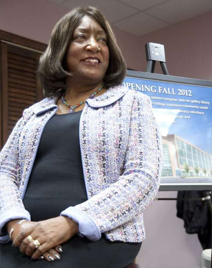 President of Gateway Community College Dorsey Kendrick poses in her office on campus in front of an artists rendering of the new Gateway Campus that will open in downtown New Haven in the fall of 2012. VM Williams/Register