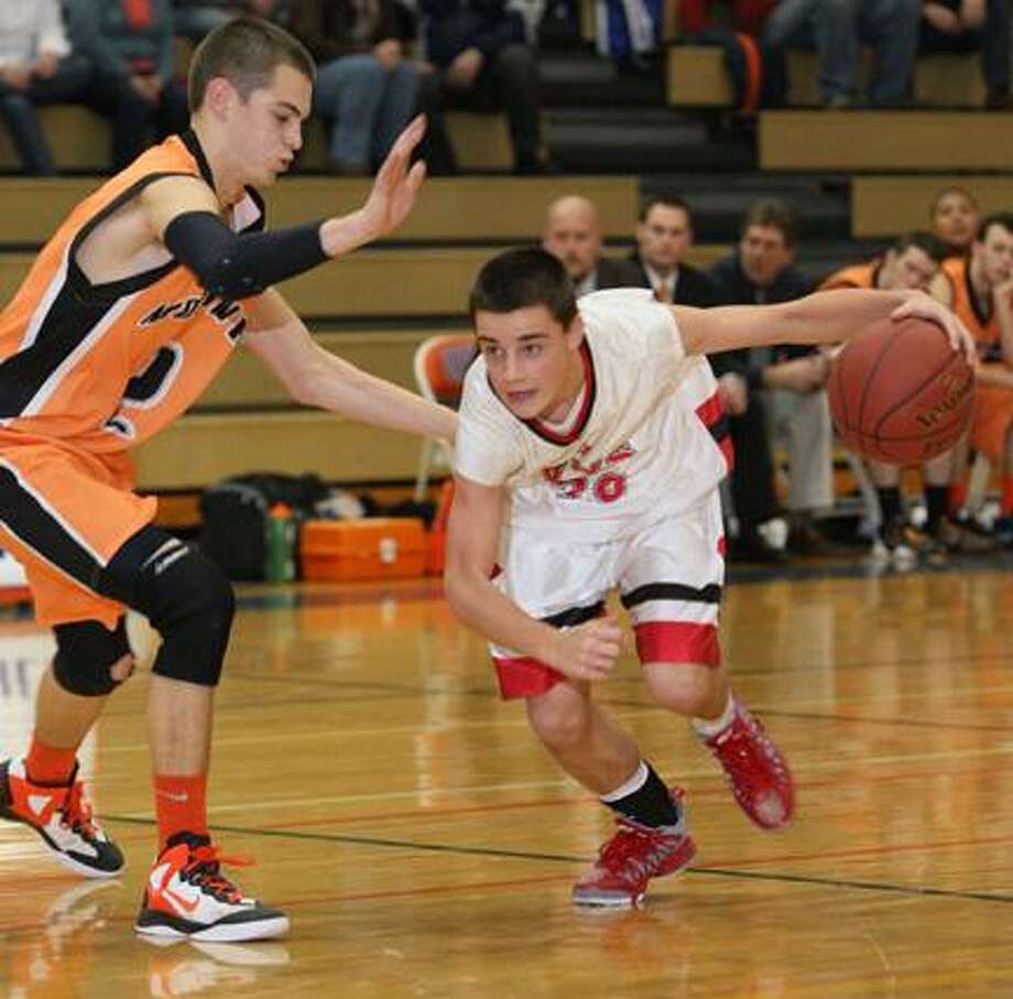 Dispatch Staff Photo by JOHN HAEGER (Twitter: @OneidaPhoto)VVS' Nick Metzger (20) brings the ball down court as Mohawk's Tyler Kehl (2) defends in the first half of their game during the 13th Annual Alliance Bank Oneida Sports Boosters Basketball Shootout on Friday, Nov. 30, 2012 in Oneida.