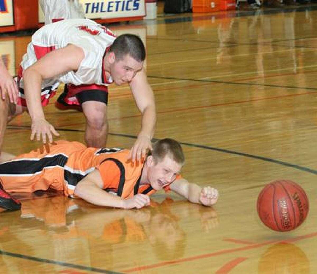 Dispatch Staff Photo by JOHN HAEGER (Twitter: @OneidaPhoto)VVS' Alex Saville (11) and Mohawk's Connor Schultz (24) dive for a loose ball in the first half of their game during the 13th Annual Alliance Bank Oneida Sports Boosters Basketball Shootout on Friday, Nov. 30, 2012 in Oneida.
