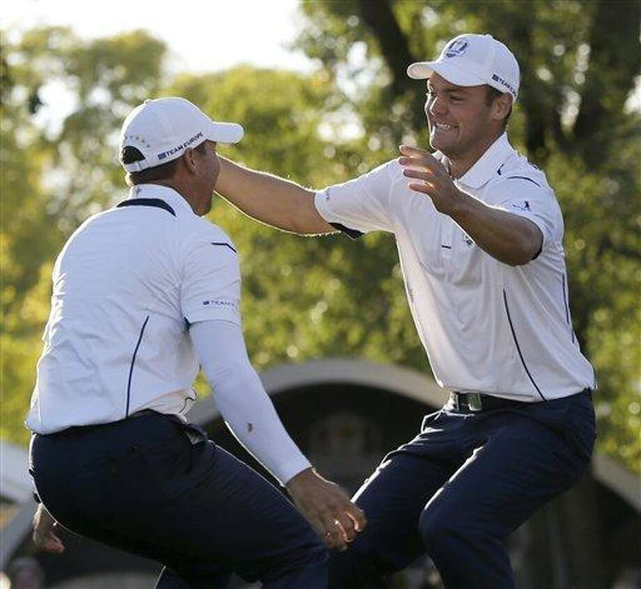 Europe's Martin Kaymer leaps into the arms of teammate Sergio Garcia after winning the Ryder Cup PGA golf tournament Sunday, Sept. 30, 2012, at the Medinah Country Club in Medinah, Ill. (AP Photo/David J. Phillip) Photo: ASSOCIATED PRESS / AP2012