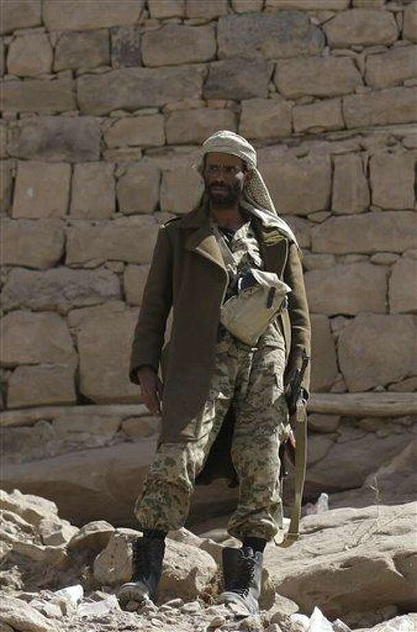 A soldier stands guard outside of Radda Castle, which was recently seized by al-Qaida militants in the town of Radda, 100 miles (160 kilometers) south of the capital, Sanaa, Yemen. A tribal leader involved in negotiating with the militants said al-Qaida militants had withdrawn from Radda, leaving the town in the control of two prominent sheiks.  Associated Press Photo: AP / AP