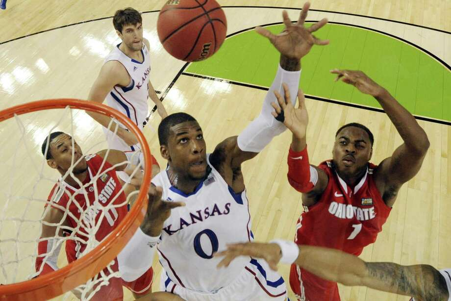 Kansas' Thomas Robinson (0) fights for a rebound with Ohio State's Deshaun Thomas (1) during the second half of an NCAA Final Four semifinal college basketball tournament game Saturday, March 31, 2012, in New Orleans. (AP Photo/Chris Steppig/NCAA Photos, Pool) Photo: ASSOCIATED PRESS / AP2012