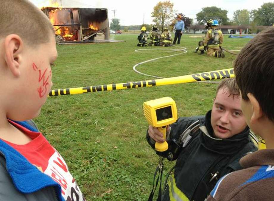 Dispatch Staff Photo by JOHN HAEGER twitter.com/oneidaphoto Sherrill firefighter Casey Cossitt-Yager show the thermal  Imaging Camera  during the live burn demonstration during the annual VVS Community Day  on Sunday, Sept. 30, 2012 in Verona.