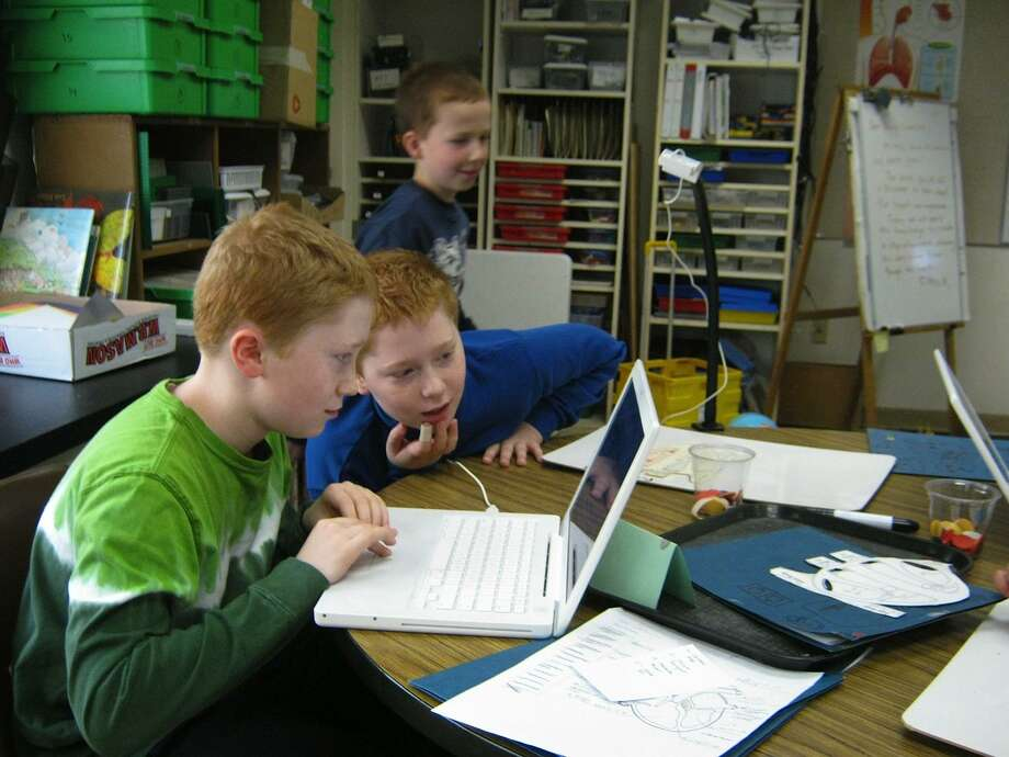 Submitted photo Eli and Caleb Dorf, of East Haddam, are enjoying working together on their SAM project.