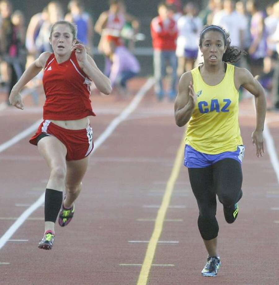 """Dispatch Staff Photo by JOHN HAEGER <a href=""""http://twitter.com/oneidaphoto"""">twitter.com/oneidaphoto</a> VVS' Lexi Kavanaugh (left) and Cazenovia's Ashley Winn battle for the win in the 100 meter finals on Thursday, May 31, 2012 at CNS. Winn won the race with a time of 12.46. Kavanaugh placed second."""