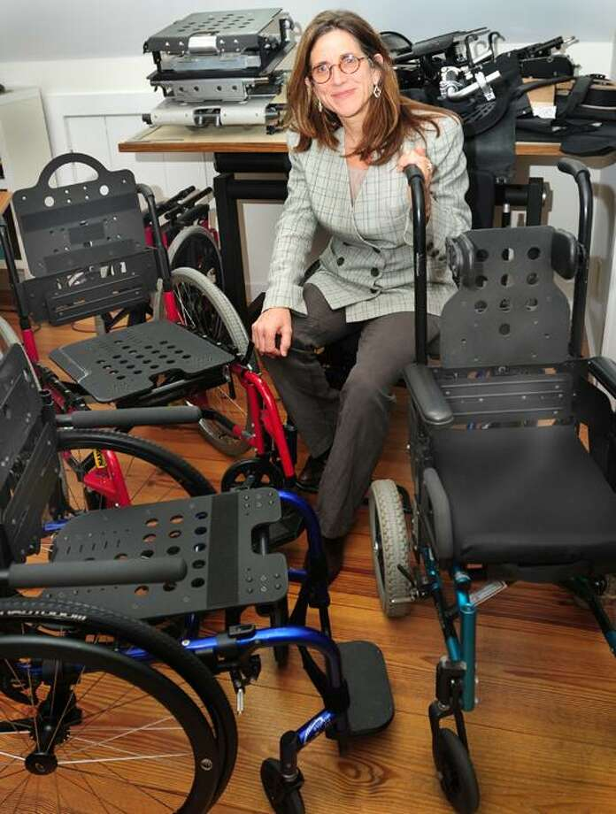Melanie Stengel/Register photo: Susan Farricielli of Kinetic Innovative Seating System in Branford has been studying wheelchair design since the late '80s.
