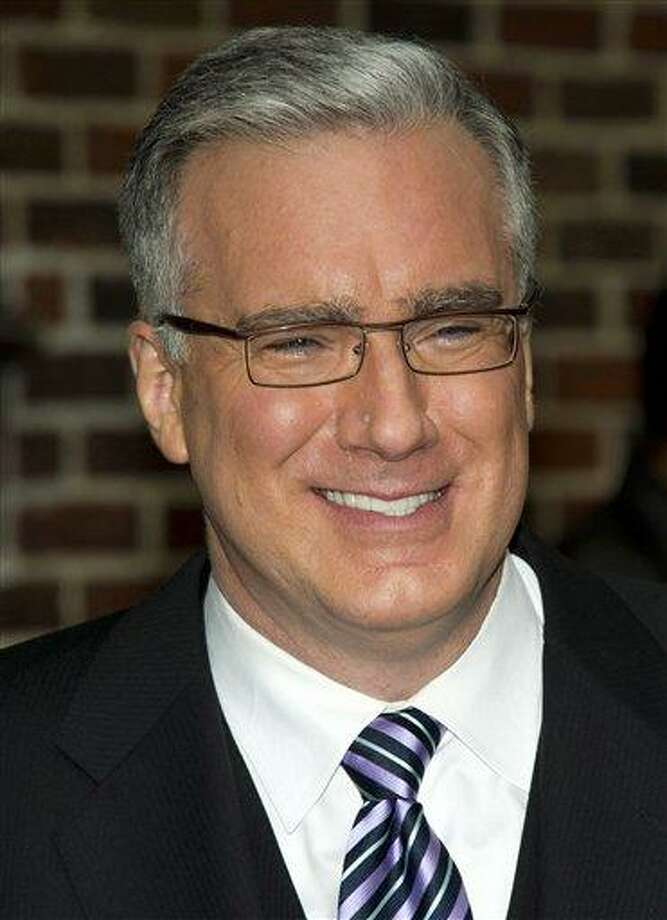 "FILE - In this Oct. 24, 2011 file photo, political pundit Keith Olbermann leaves a taping of the ""Late Show with David Letterman,"" in New York. Current TV says it has ejected Keith Olbermann from its talk-show lineup after less than a year. The network announced late Friday afternoon that ""Countdown,"" the show Olbermann has hosted since last June, was to be replaced with a show hosted by former New York Gov. Eliot Spitzer, beginning Friday night. (AP Photo/Charles Sykes, file) Photo: AP / AP2011"