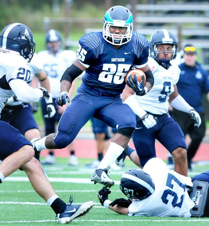 Vaughn Magee (center) of Southern runs through the St. Anselm defense in the first half on 9/29/2012.Photo by Arnold Gold/New Haven Register