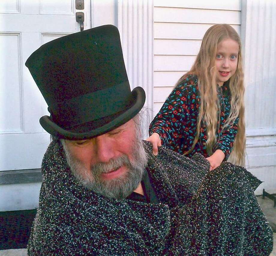 """Contributed photo: Dana Sachs, left, as Ebenezer Scrooge, is pulled into the past by Spirit Emily May in """"A Christmas Carol."""""""