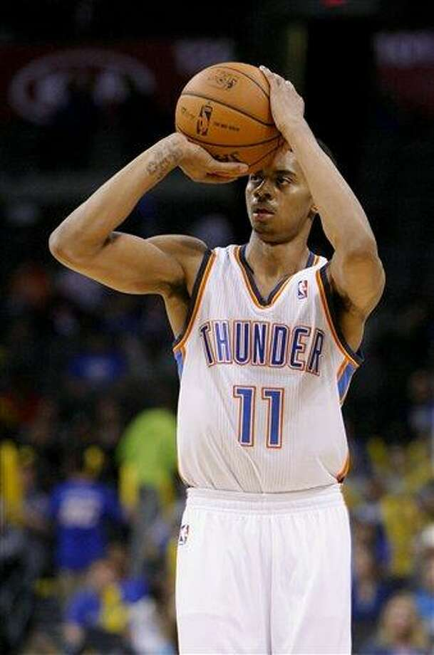 Oklahoma City Thunder shooting guard Jeremy Lamb (11) lines up his shot against the Toronto Raptors in the fourth quarter of an NBA basketball game in Oklahoma City, Tuesday, Nov. 6, 2012.  Oklahoma City won 108-88.  (AP Photo/Alonzo Adams) Photo: ASSOCIATED PRESS / AP2012