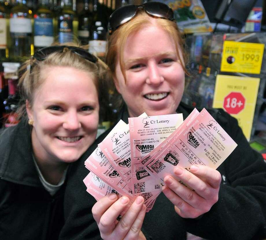 Branford-- Mary Stowers, left and Emily Hayes show off the tickets they bought at the Stony Creek Package store, hoping to hit the $640 Million Mega Millions jackpot, the largest lottery jackpot ever. They are from Stony Creek.  Photo- Peter Casolino/New Haven Register 03/30/12