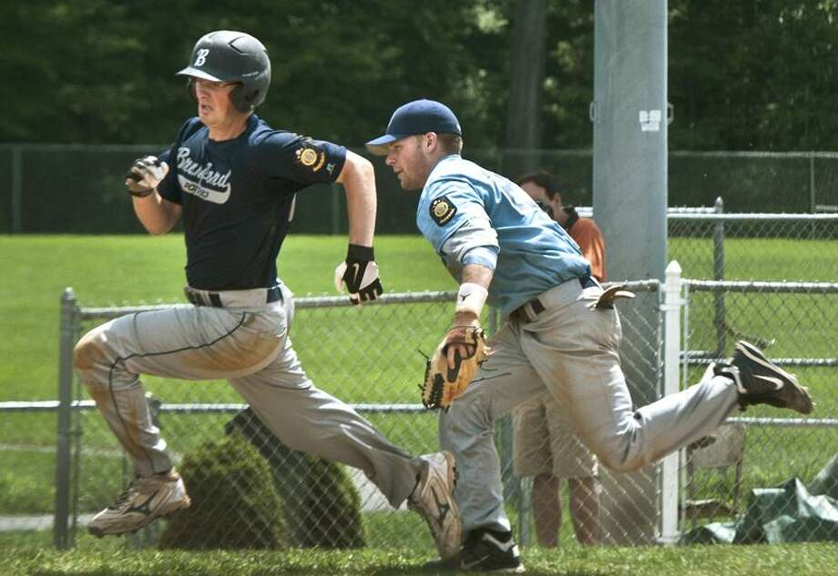 Sports--Branford's Michael Cattaruzza tries to out run Milford 3rd baseman Ed Michaud to score in the 7th inning of the American Legion Playoff game. Branford  unsuccessfully attempted a double steal.  Cattaruzza was tagged out.  Melanie Sytengel/Register