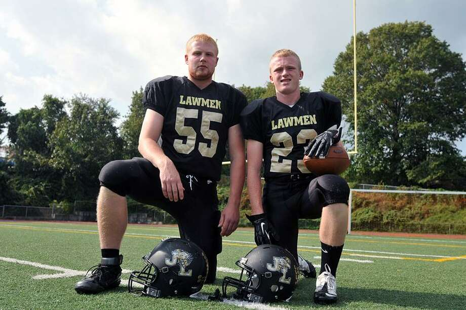 Milford-- Law High Captains George Knoth, left, and Tim Speer, . Photo Peter Casolino/New Haven Register 09/27/12