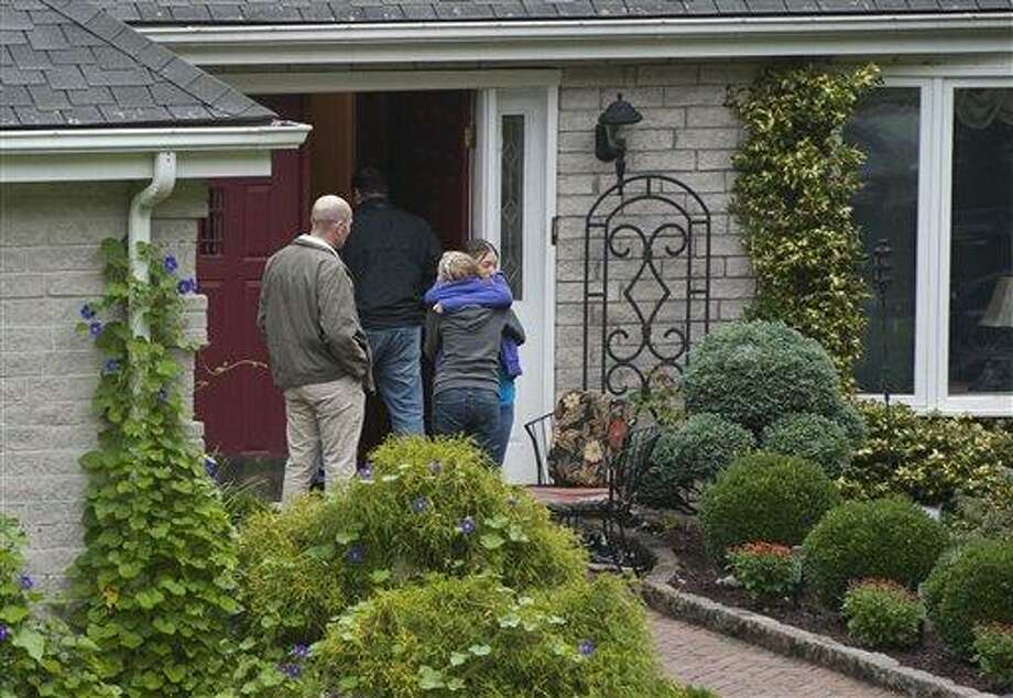Visitors arrive at the home of Jeffrey Giuliano in New Fairfield, Conn., Friday. Giuliano fatally shot a masked teenager in self-defense during what appeared to be an attempted burglary early Thursday morning, then discovered that he had killed his son, Tyler, state police said. (AP Photo/Jessica Hill) Photo: AP / FR125654 AP