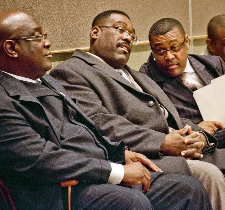 From left, the Rev. Boise Kimber, former Alderman Charles Blango and the Rev. James Newman attend a community meeting Thursday concerning the future of New Haven's former Martin Luther King School. Melanie Stengel/Register