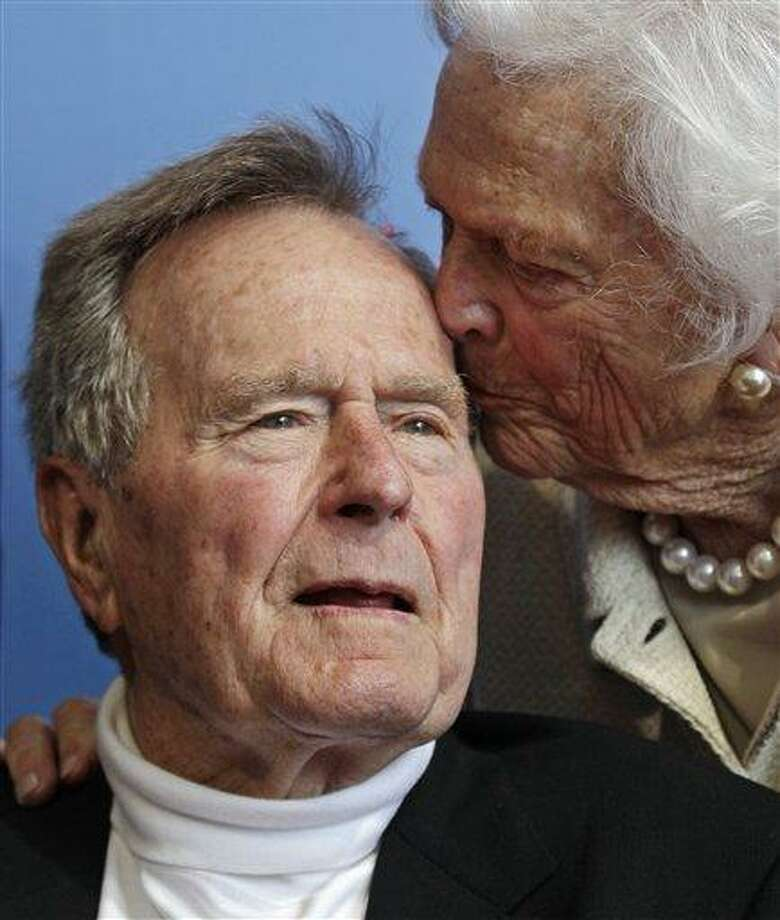 FILE - In a Tuesday, June 12, 2012 file photo, former President George H.W. Bush, and his wife former first lady Barbara Bush, arrive for the premiere of HBO's new documentary on his life near the family compound in Kennebunkport, Maine. Former President Bush has been hospitalized for about a week in Houston for treatment of a lingering cough. Bush's chief of staff, Jean Becker, says the 88-year-old former president is being treated for bronchitis at Houston's Methodist Hospital and is expected to be released by the weekend. He was admitted Friday, Nov. 23, 2012.  (AP Photo/Charles Krupa, File) Photo: AP / AP