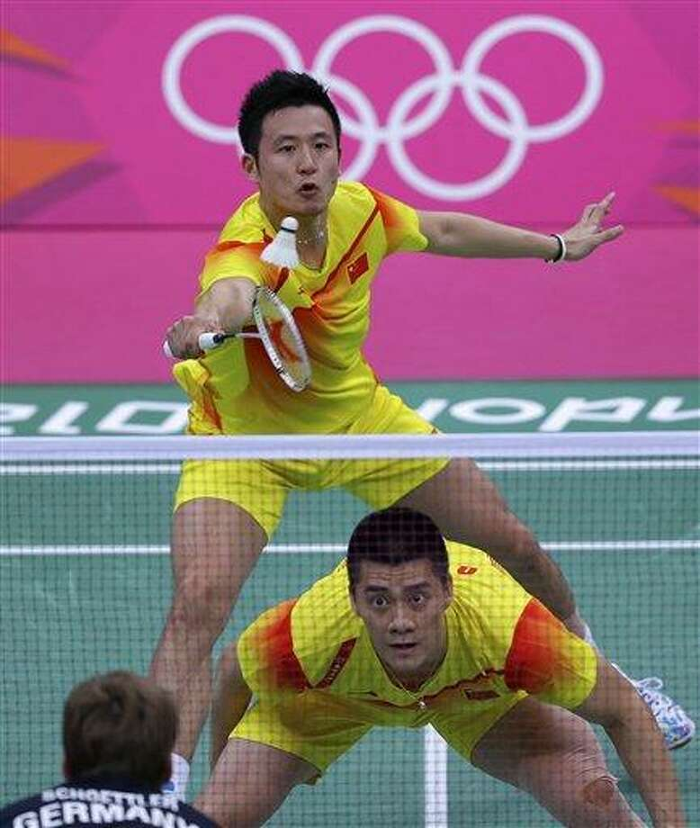 China's Cai Yun, top left, and Fu Haifeng play against Germany's Johannes Schoettler, foreground, and Ingo Kindervater, unseen, at a men's doubles badminton match of the 2012 Summer Olympics, Sunday, July 29, 2012, in London. (AP Photo/Saurabh Das) Photo: AP / AP