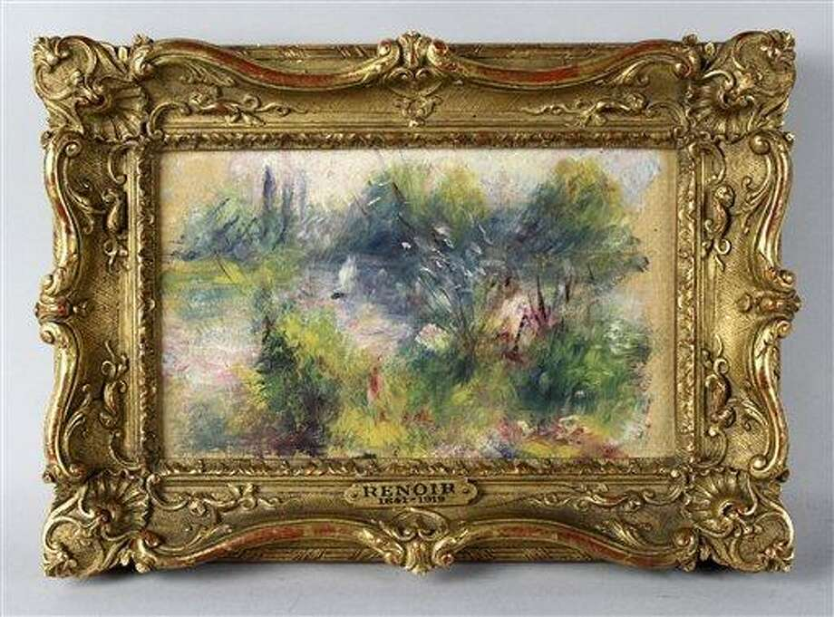 """This undated image provided by the Potomack Company shows an apparently original painting by French impressionist Pierre-Auguste Renoir that was acquired by a woman from Virginia who stopped at a flea market in West Virginia and paid $7 for a box of trinkets that included the painting. An auction house has put on hold the sale of a painting believed to be by French impressionist Pierre-Auguste Renoir that a woman bought at a West Virginia flea market because a reporter found evidence someone stole the painting from the Baltimore Museum of Art.  A Washington Post reporter discovered documents in the museum's library showing the painting was there from 1937 until 1949. Museum officials then found paperwork showing the painting, """"Paysage Bords de Seine,"""" was stolen in 1951.   (AP Photo) Photo: AP / Potomack Company"""