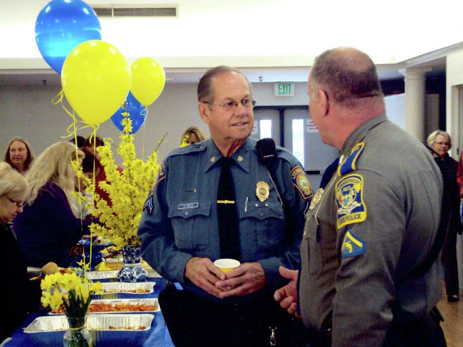 """RICKY CAMPBELL/Register Citizen Litchfield Cpl. Roger """"Dodgie"""" Doyle  greets Litchfield Resident State Trooper First Class James Holm during Doyle's farewell luncheon Friday at Bantam Fire Company. The lunch, which was attended by Litchfield town employees, was on Doyle's last day before retirement. He served 46 years policing and helping his hometown."""