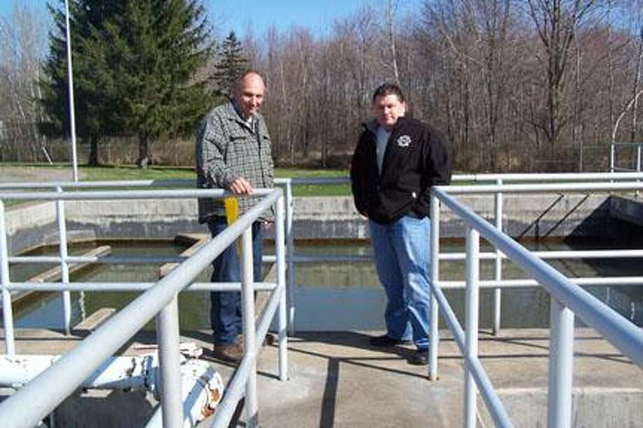 Photo Special to The Dispatch by Jen ArmstrongMayor Rick Stewart and Chief Operator Bill Defazio standing at the final tanks before treated water is discharged into Fish Creek.