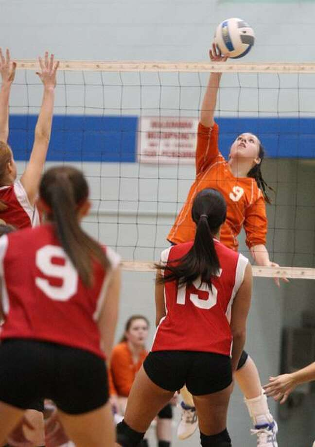 Dispatch Staff Photo  by JOHN HAEGER (Twitter @OneidaPhoto) Oneida's Marissa Smith (9) puts a shot over the net as VVS'  Sam Kogut (15) and Alexis Kavanaugh (9) defend in the first game of their match at Oneida on Thursday. Oneida won 3-0.