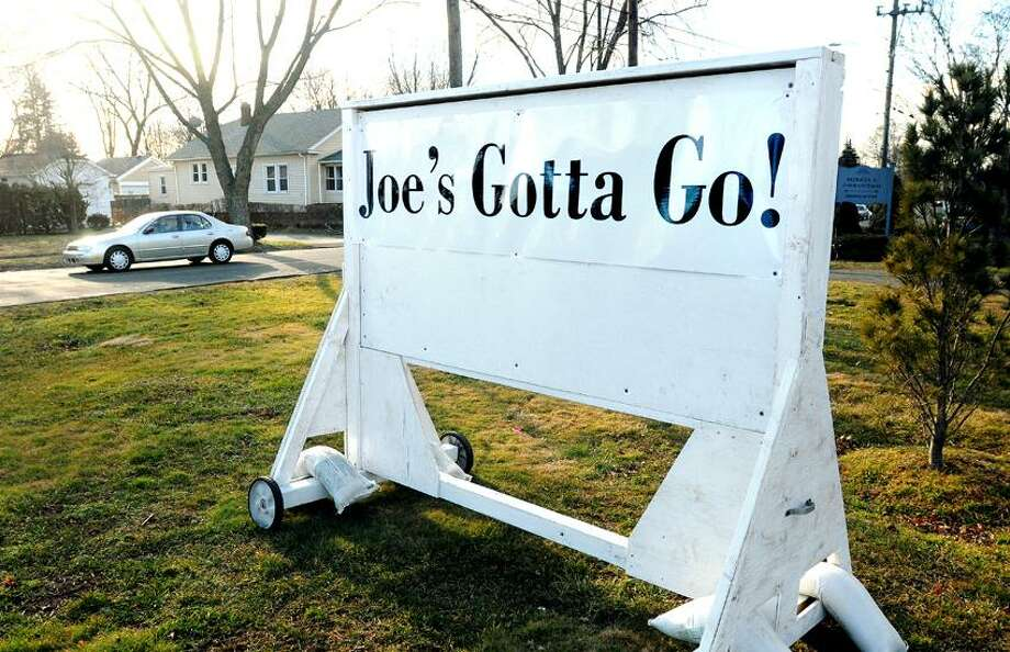 A sign looking for the resignation of Republican East Haven Mayor Joseph Maturo Jr. sits at the corner of Kimberly Avenue and Forbes Place in East Haven. The sign is on property owned by former Town Attorney Patricia Cofrancesco, who served with Maturo's predecessor, Democrat April Capone. Arnold Gold/Register