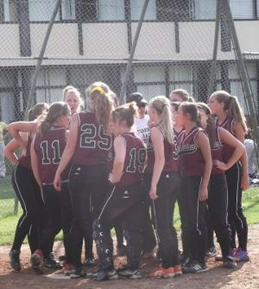 KEVIN D. ROBERTS/Register Citizen Torrington softball breaks its postgame huddle after a 1-0 win over Bristol Central in a Class L second round game on Wednesday afternoon at Torrington High School. The Lady Raiders will play in a Class L quarterfinal at home on Friday at 4 p.m.