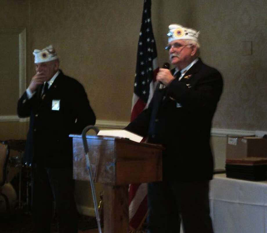 RICKY CAMPBELL/ Register Citizen American Veterans Post 24 Commander Frank Dlugokinski made announcements Sunday during the organization's annual awards dinner at P. Sam's Bar and Grill in Torrington.