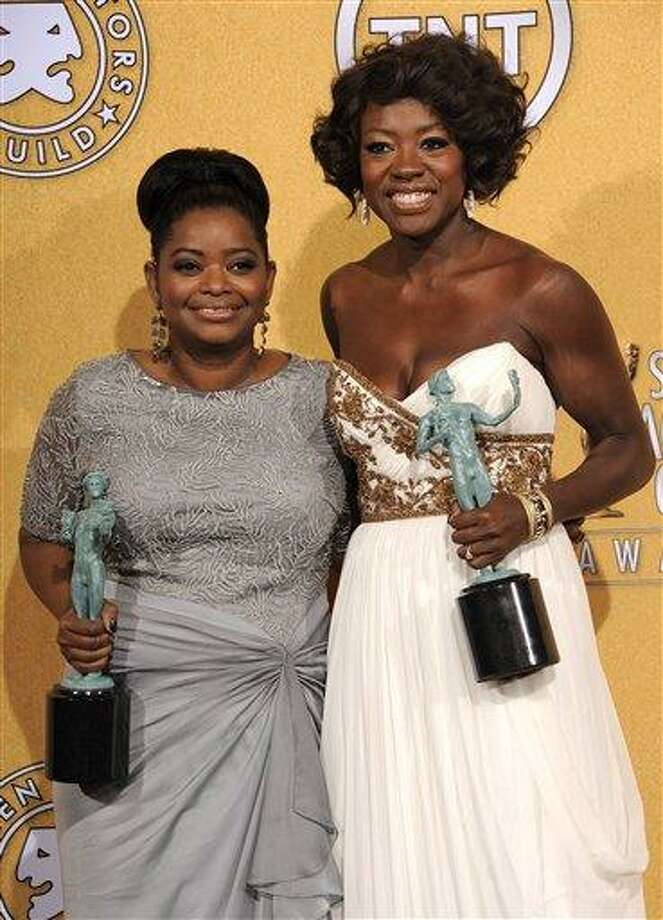 "Octavia Spencer, winner of award for outstanding performance by a female actor in a supporting role for ""The Help,"" left, and Viola Davis, winner of the award for outstanding performance by a female actor in a leading role for ""The Help,"" pose backstage at the 18th Annual Screen Actors Guild Awards on Sunday Jan. 29, 2012 in Los Angeles. Photo: AP / AP"