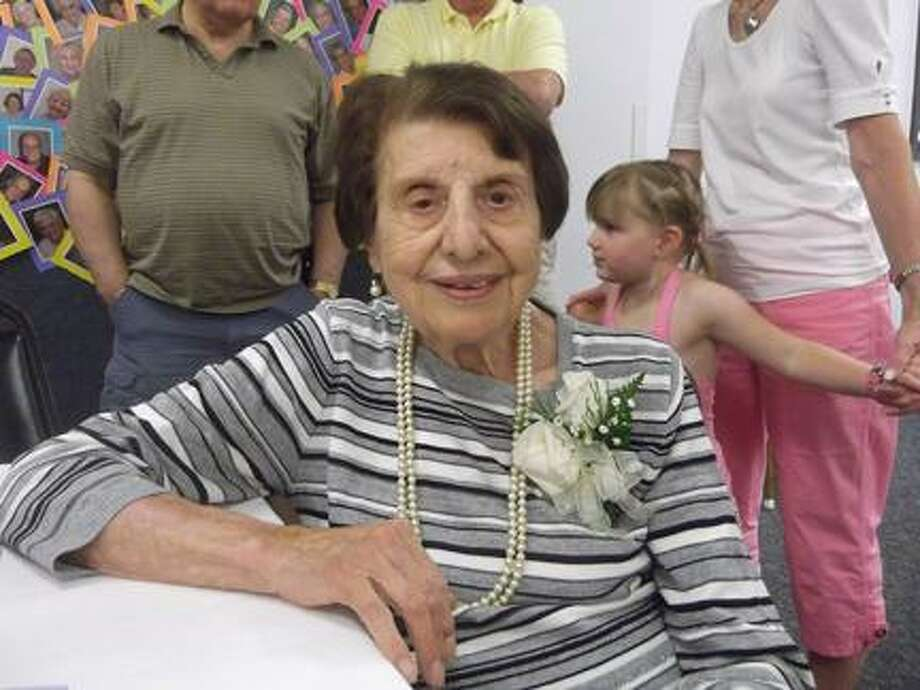 "MICHELLE MERLIN/Register Citizen Philomenia ""Minnie"" Giannattasio celebrated her 100th birthday with family and friends at the Sullivan Senior Center on Wednesday."