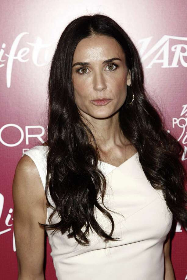 "Demi Moore arrives at Variety's 3rd Annual Power of Women Luncheon in Beverly Hills, Calif., in this Sept. 23, 2011 photo. A 911 recording released Friday Jan. 27, 2012 by Los Angeles fire officials revealed frantic efforts by friends of Demi Moore to get help for the actress who was convulsing as they gathered around her and tried to comfort her. Moore was ""semi-conscious, barely,"" according to a female caller on the recording.  (AP Photo/Matt Sayles) Photo: AP / AP2011"