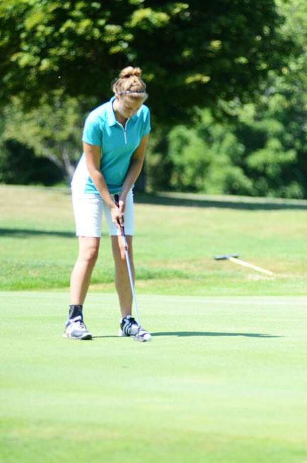 Dispatch Staff Photo by KYLE MENNIGVernon-Verona-SherrillÕs Amanda Snizek putts on the fourth green during the Mohawk Valley Junior Golf Tour event at Oneida Community Golf Club Monday, July 30, 2012. Snizek shot a 98 to finish second in her division.