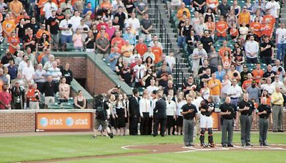 Photo Courtesy Holy Cross Academy The Holy Cross Academy Select Choir performs the national anthem at Camden Yards prior to the Orioles game on May 25, 2012.