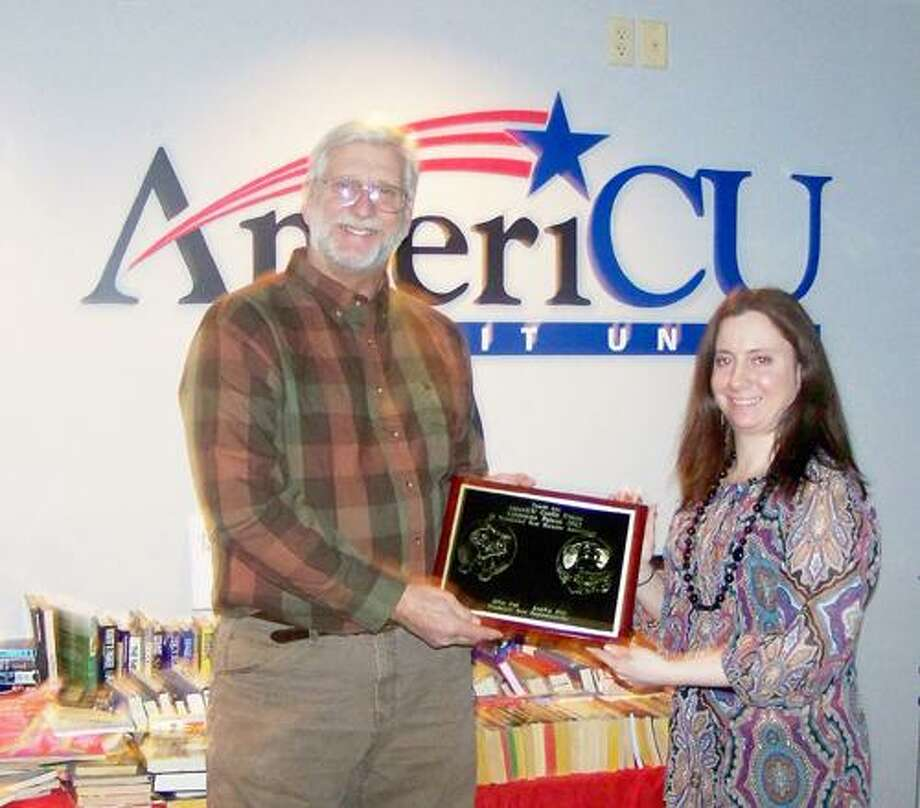 SUBMITTED PHOTO Glenn H. Ivers, executive director of the Wanderers' Rest Humane Association, presents Rachel Siderine, Financial Center manager of AmeriCU Credit Union, a plaque for their business as the first corporate patron sponsor of Wanderers' Rest. The Wanderers' Rest Humane Association has started a new sponsorship program in 2012.