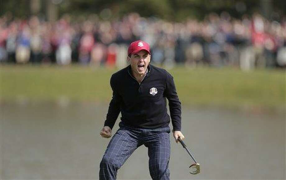 USA's Keegan Bradley celebrates after winning their foursomes match on the 15th hole at the Ryder Cup PGA golf tournament Friday, Sept. 28, 2012, at the Medinah Country Club in Medinah, Ill. (AP Photo/Charlie Riedel) Photo: ASSOCIATED PRESS / AP2012