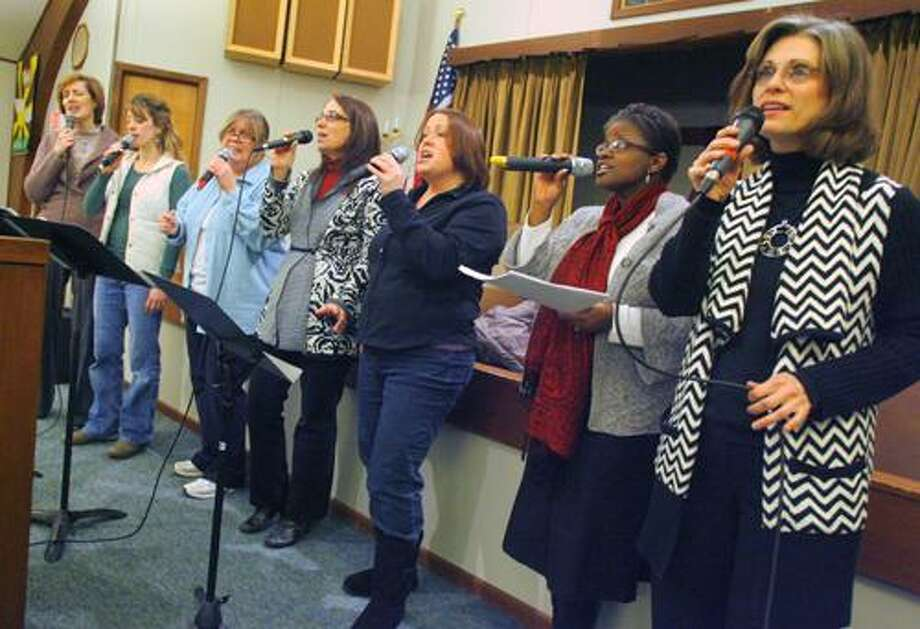 Photo by JOHN HAEGER (Twitter.com/OneidaPhoto) Tapestry members Sue Maxfield, Jennifer MacAlpine, Carol Allison, Lisa Bisha, Melanie Bex , Dee Brennen and Valerie Stedman rehearse for the upcoming 5th annual Concert for Hunger on Monday, Jan. 30, 2012 in Chittenango. The concert will take place on Saturday feb. 4, 2012 at the Chittenango High School Auditorium at 7 p.m.