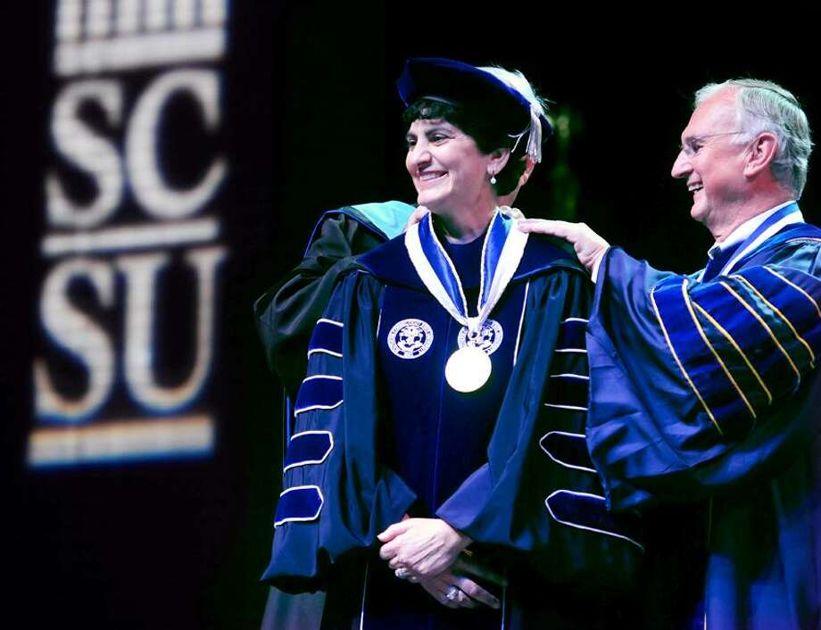 Mary Papazian (center) is invested by Michael Meotti (behind Papazian), Executive Vice President of the Board of Regents, and Robert Kennedy (right), President of the Board of Regents, as the eleventh President of Southern Connecticut State University at the John Lyman Center for the Performing Arts on 9/28/2012.Photo by Arnold Gold/New Haven Register   AG0464B