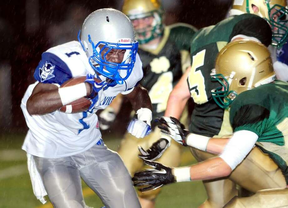 Ervin Philips (left) of West Haven runs for a touchdown in the first quarter against Notre Dame on 9/28/2012. Photo by Arnold Gold/New Haven Register   AG0464B