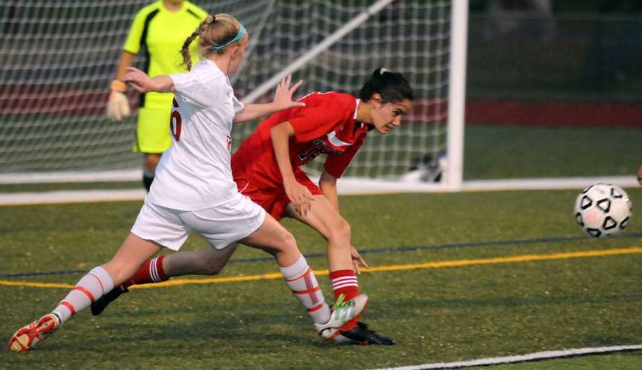 Action from an SCC girls' soccer match involving Cheshire and Wilbur Cross.