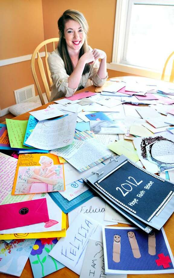 Hannah Brencher, founder of The World Needs More Love Letters (moreloveletters.com), is photographed with a pile of the the letters at her home in North Haven. Photo by Arnold Gold/New Haven Register