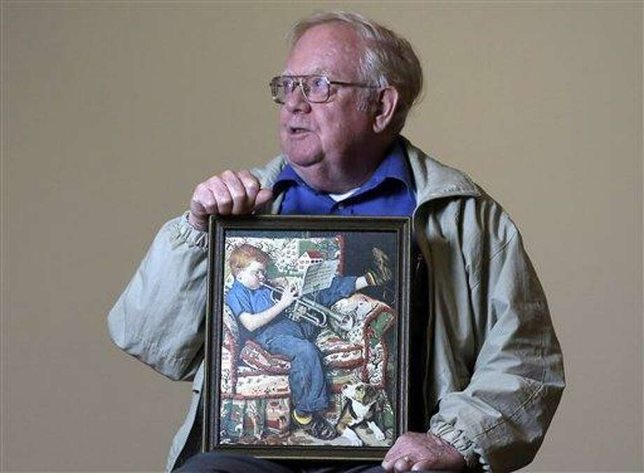 Tom Paquin of North Bennington, Vt., poses with a 1950 Saturday Evening Post illustration by Norman Rockwell for which he modeled at the Bennington Museum on Friday, in Bennington, Vt. (AP Photo) Photo: AP / AP