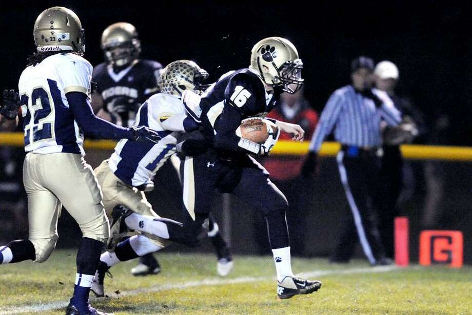 Daniel Hand quarterback Brendan Bilcheck (right) runs for a touchdown against Platt in the first half of the CIAC quarterfinal in Madison on 11/28/2012.Photo by Arnold Gold/New Haven Register   AG0473B