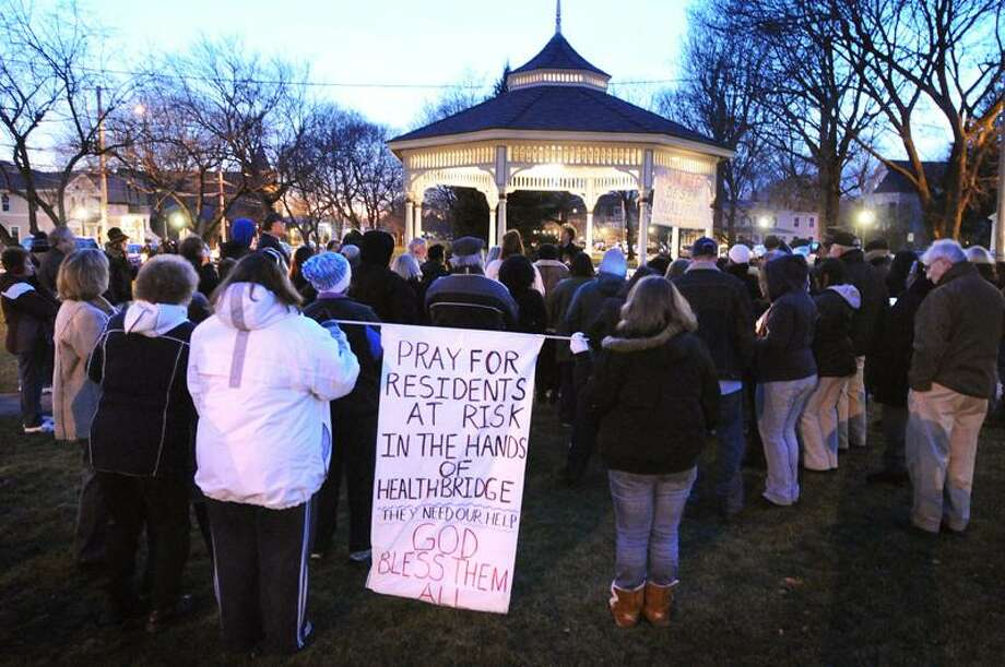 Employees and residents hold signs and candles during a prayer service for locked-out employees of the West River Health Care Center.   Peter Casolino/Register