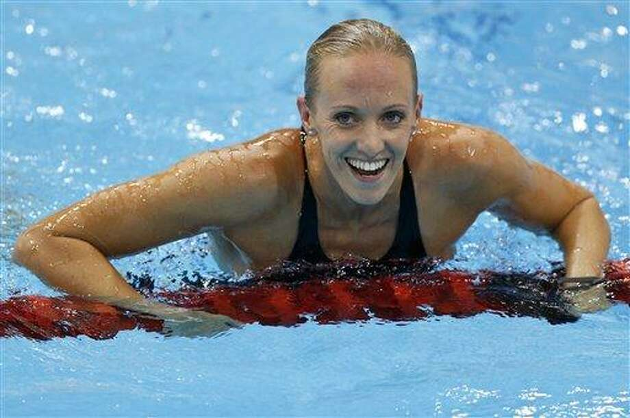 United States' Dana Vollmer reacts to her gold medal win in the he women's 100-meter butterfly swimming final at the Aquatics Centre Sunday in the Olympic Park during the 2012 Summer Olympics in London. Associated Press Photo: AP / AP