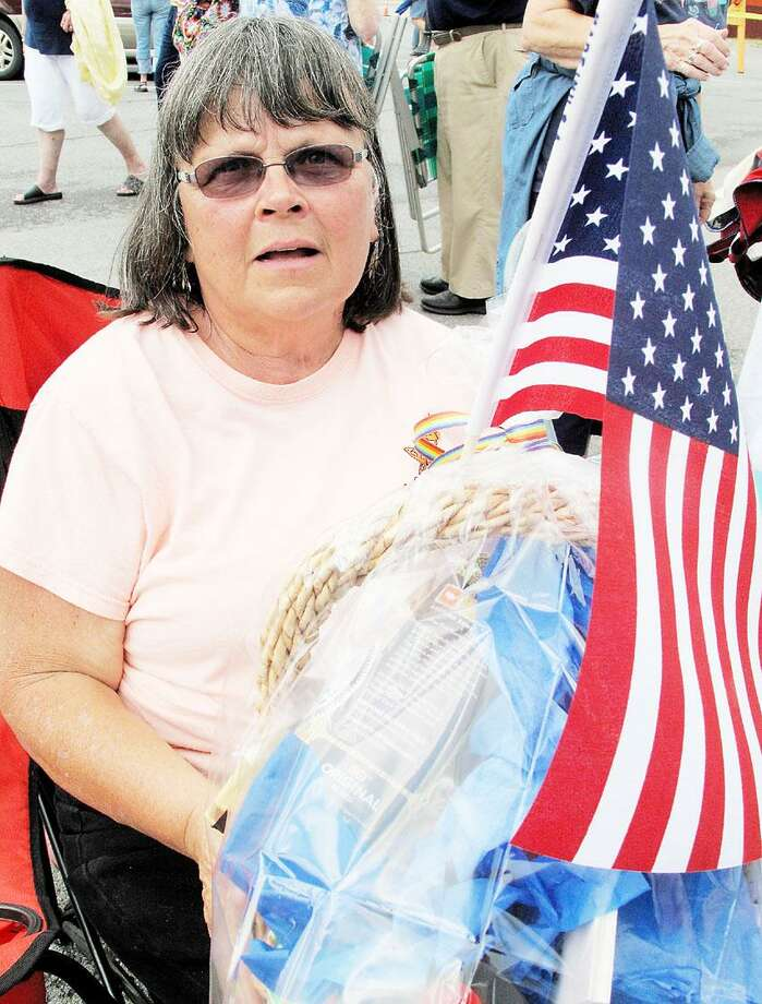 """Dispatch Staff Photo by JOHN HAEGER <a href=""""http://twitter.com/oneidaphoto"""">twitter.com/oneidaphoto</a> Linda Kendall of Chittenango, winner of the medalion contest, poses with the gift basket she won on Saturday, July 28, 2012 in Chittenango."""