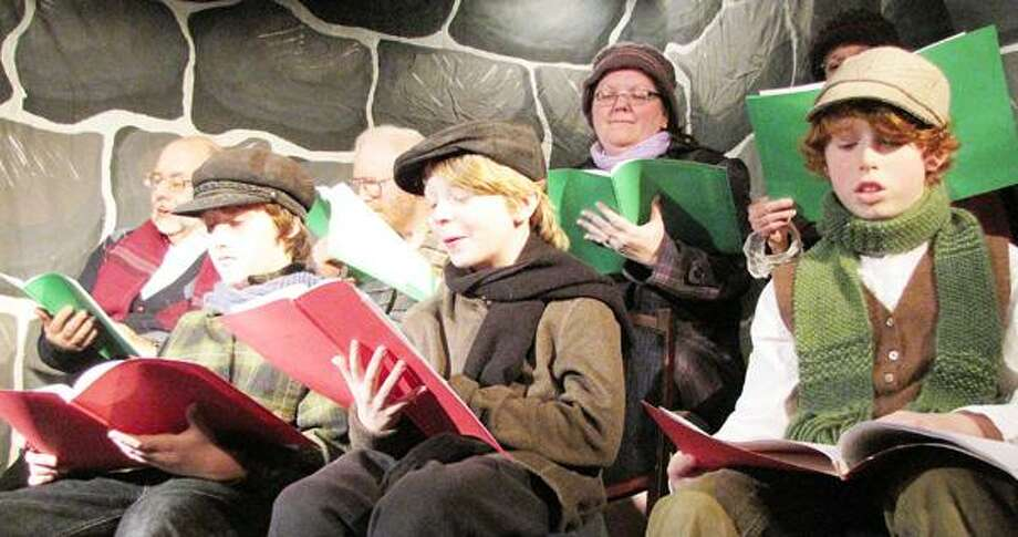 """Photo Courtesy THE PALACE THEATER Actors do a dramatic reading of Dylan Thomas' """"A Child's Christmas in Wales"""" last year. This year's reading will be Sunday, Dec. 9, 2012, at 3:30 p.m."""